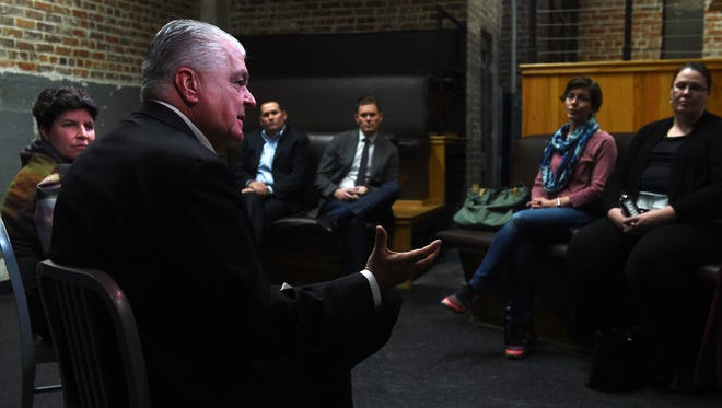 Steve Sisolak, Democratic candidate for governor and chairman of the Clark County Board of Commissioners, speaks to those gathered for an economic development roundtable in a common area at The Basement in Reno on Dec. 13, 2017.