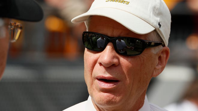 FILE - In this Sept. 16, 2018, file photo, Pittsburgh Steelers President Art Rooney II talks with visitors on the sideline before an NFL football game against the Kansas City Chiefs, in Pittsburgh. Rooney remains confident in head coach Mike Tomlin despite a late-season collapse but is eyeing what to do with disgruntled wide receiver Antonio Brown.(AP Photo/Gene J. Puskar, File)