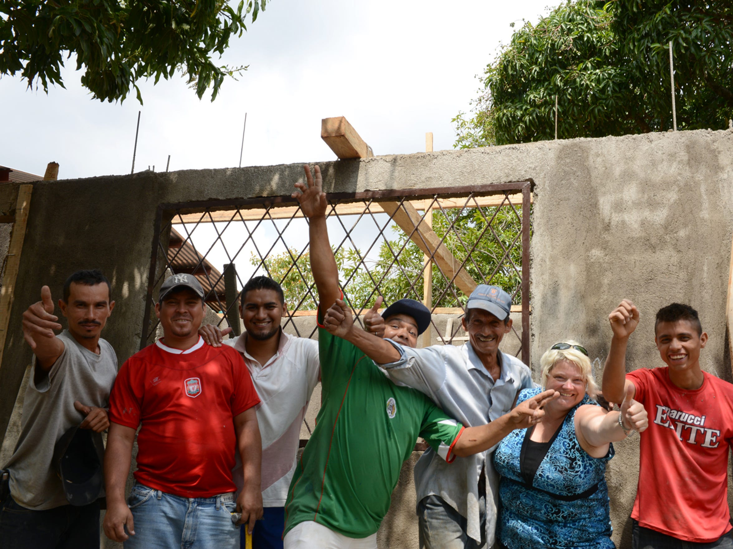 Kris and a group of people working to build a new school.