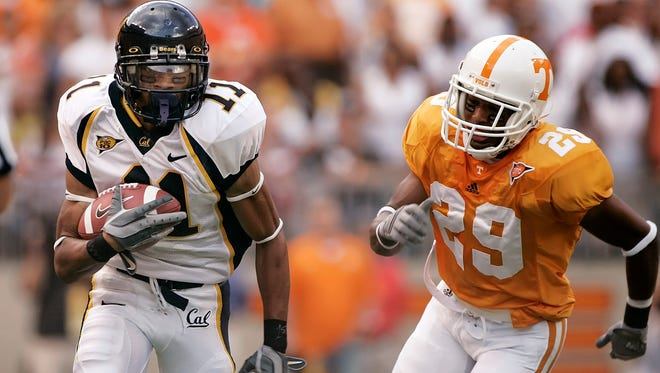 California wide receiver Robert Jordan (11) is chased by Tennessee defensive back Inquoris Johnson (29) in the first quarter of a college football game on Saturday, Sept. 2, 2006 in Knoxville, Tenn. (AP Photo/Mark Humphrey)