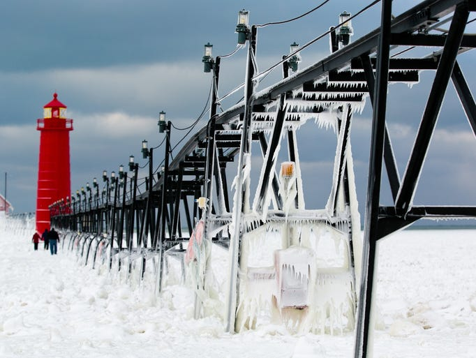 Frozen water clings to the Grand Haven South Pier on Jan. 8 in Grand Haven, Mich.