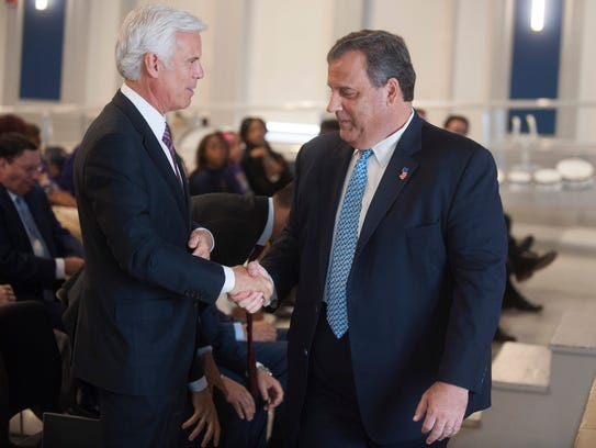 Former New Jersey Governor Chris Christie, right, shakes