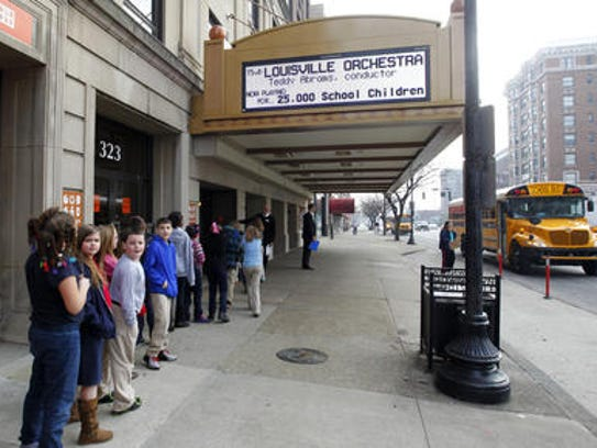 Elementary School students arrive at the Brown Theatre