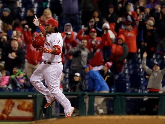 Philadelphia Phillies' Maikel Franco celebrates after his game-winning two-run hit during the 10th inning of a baseball game against the Atlanta Braves, Saturday, April 22, 2017, in Philadelphia. (AP Photo/Matt Slocum)