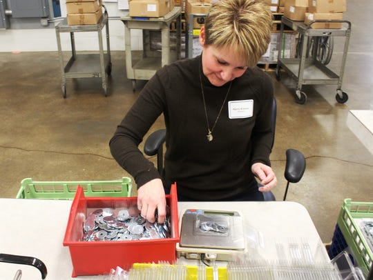 Kerry Kremer, a new employee at Sargento Foods, volunteered