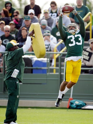 Packers safety Micah Hyde goes up for a ball during training camp practice.