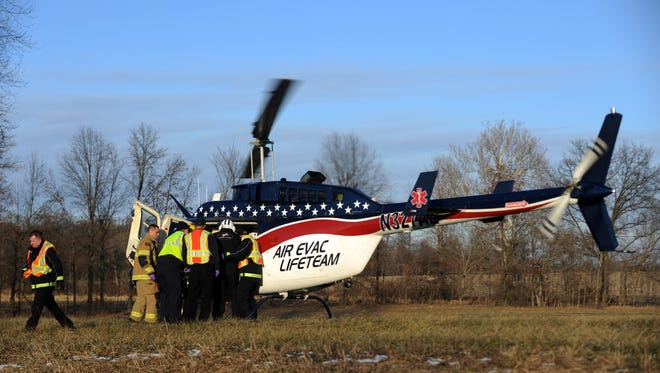 Basil Joint Fire District firefighters load a patient into a waiting helicopter Thursday, Dec. 28, 2017, in Liberty Townsihp. The driver of a car was flown to Grant Medical Center in Columbus after driving head on into a tree on Basil Road north of Baltimore.