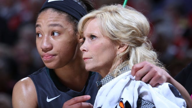 Michigan State star Aerial Powers, left, and coach Suzy Merchant will have to begin their NCAA tournament run in Starkville, Miss., due to a conflict at Breslin Center.