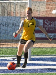 Dixie State goalie Stacie Gubler kicks the ball back into play during their game against Chaminade Saturday, Oct. 31, 2015.