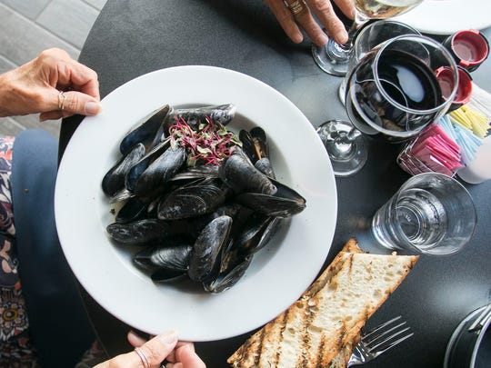 A plate of mussels sits in front of Lyda Gentzler of