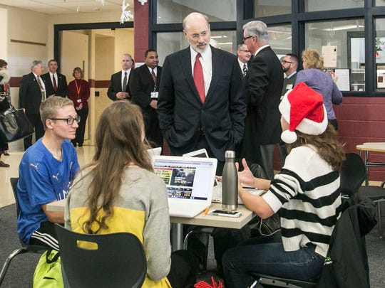 Gov. Tom Wolf, speaks with Central York students  Cole Bailey, left,  Maddie Frazier and Isabella Kostic, right, in their Apollo class, during the Schools That Teach Tour Monday, Dec. 19, 2016, at Central York High School in Springettsbury Township. Amanda J. Cain photo