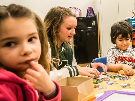 York Tech senior Summer Schanberger, helps Ryan Robinson, right, 5, with his puzzle pieces, as Cecilia Nicolae, 5, looks over at her teacher, during a York Tech/LIU preschool class Tuesday, April 4, 2017, at York County School of Technology. Schanberger, along with two other students Samantha Flickinger and Cassandra Shermeyer, won a Gold medal at the FCCLA (Family, Career and Community Leaders of America), for advocating a change in regulation to allow volunteers from approved technical programs to work in a licensed childcare facility under the age of 16. Amanda J. Cain photo