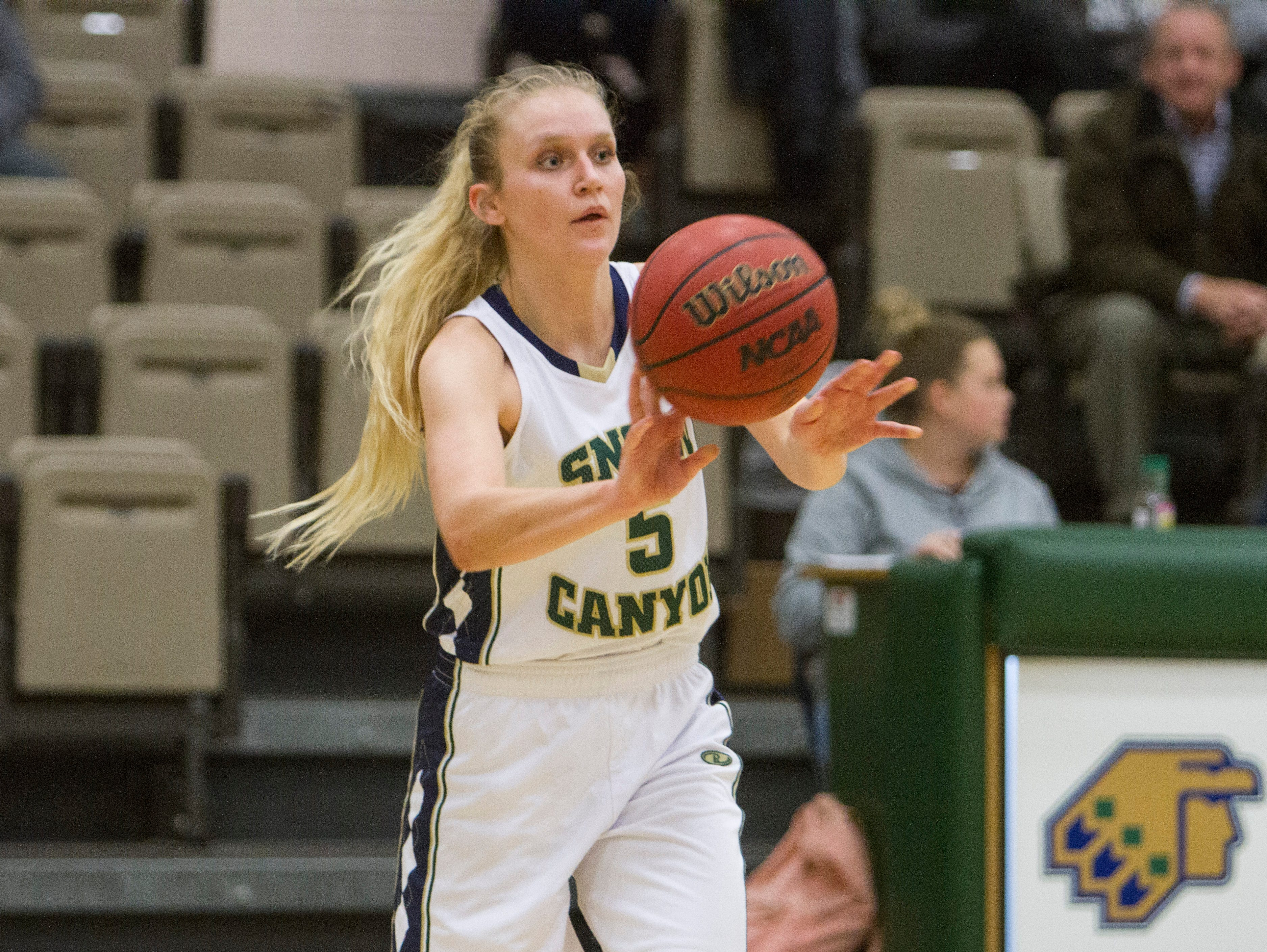 Snow Canyon's Shaylee Reed passes off to a teammate against Canyon View on Thursday in St. George. Reed is one of eight seniors to give the Warriors a ton of experience this season.