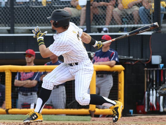 Southern Miss' Hunter Slater swings at a pitch against