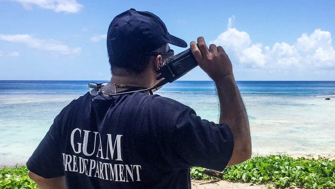 Guam Fire Department personnel at a rescue operation.