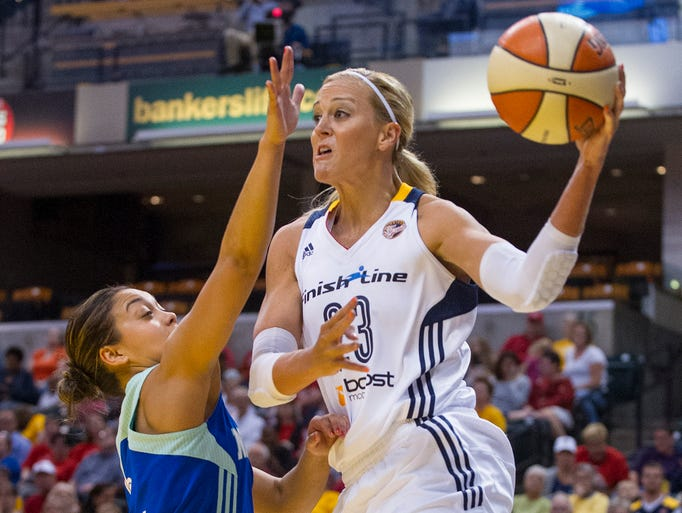 Indiana Fever's Katie Douglas (23) fires a pass off to a teammate from under the basket during the first half of an WNBA basketball game at Bankers Life Fieldhouse in Indianapolis, Friday, Sept. 13, 2013.