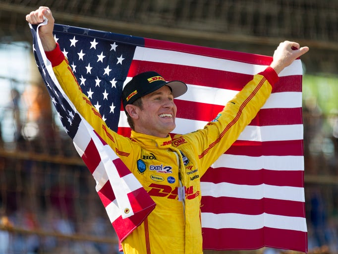 Ryan Hunter-Reay celebrates after winning the 98th Indianapolis 500 at the Indianapolis Motor Speedway, Sunday, May 25, 2014.