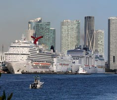 Cruise ships line up along Port Miami on March 15 in Miami, Fla.