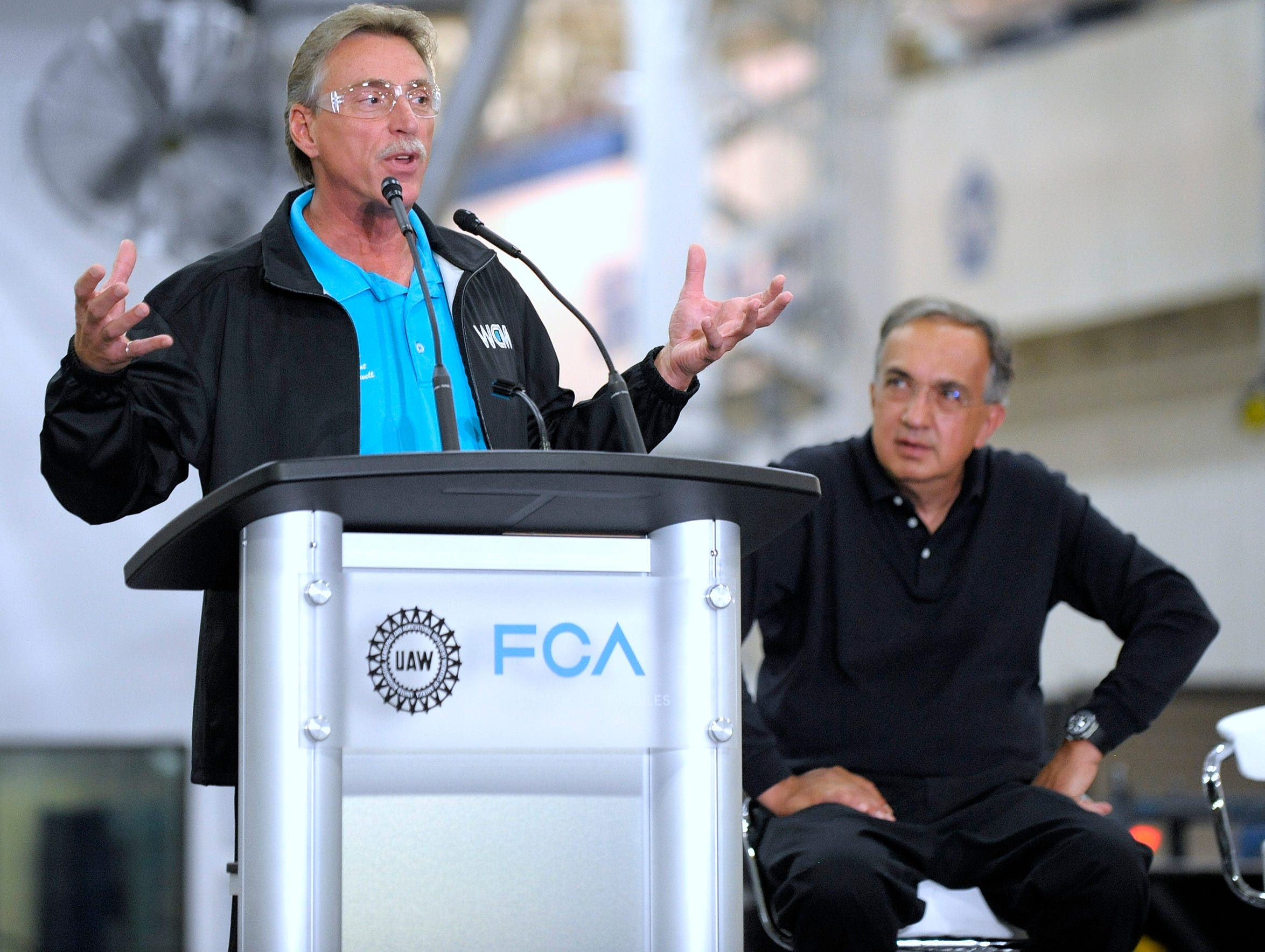 Norwood Jewell, UAW V.P. of the FCA US Department, speaks at the Sterling Stamping Plant in 2016 s FCA CEO Sergio Marchionne listens.