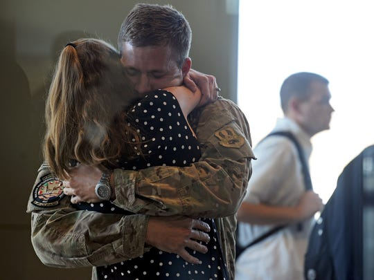 Captain Rob Willoughby hugs his wife, Laura, at the Wichita Falls Regional Airport on Jan. 23, 2015 after seeing her for the first time in nearly seven months. Rob had just returned from a 6-month deployment to Qatar.