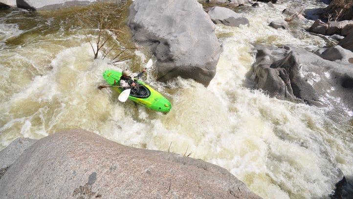 Cody Howard runs a flooded Sycamore Creek in the Tonto