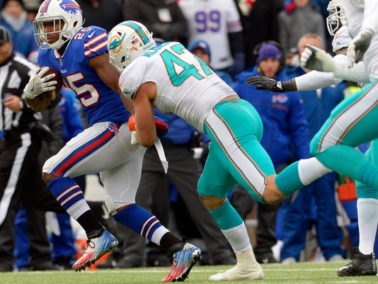 Buffalo Bills running back LeSean McCoy (25) is tackled by Miami Dolphins' Kiko Alonso (47) during the first half of an NFL football game Sunday, Dec. 17, 2017, in Orchard Park, N.Y.  McCoy became the 30th player in NFL history to reach 10,000 yards rushing with the play. (AP Photo/Adrian Kraus)