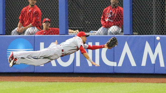 Jun 26, 2015; New York City, NY, USA; Cincinnati Reds center fielder Billy Hamilton (6) misses the ball hit by New York Mets second baseman Dilson Herrera (not pictured) during the fifth inning at Citi Field. Mandatory Credit: Anthony Gruppuso-USA TODAY Sports