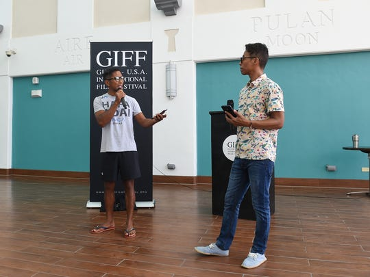 GIFF co-founders Don Muña, left, and Kel Muña discuss rules and guidelines of the GIFF/PDN Island-wide Youth Film Competition during an orientation at the Guam Museum on Jan. 13, 2018.