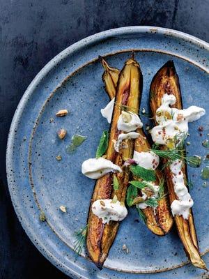 "This roasted eggplant dish with a feta yogurt is from ""Falastin"" by Sami Tamimi, Tara Wigley and Yotam Ottolenghi."