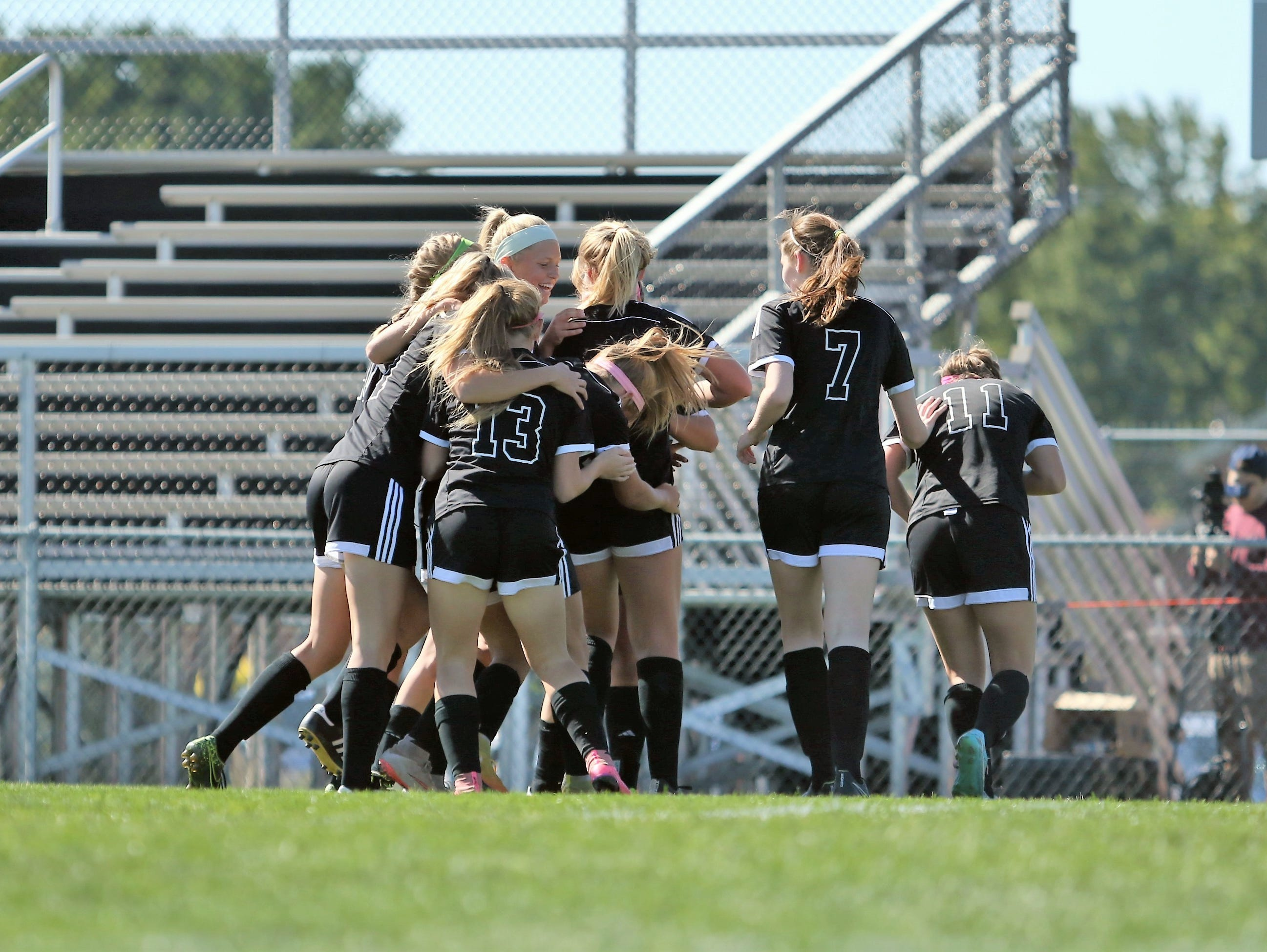 Noblesville players celebrate after a goal in their win over Hamilton Southeastern Saturday.