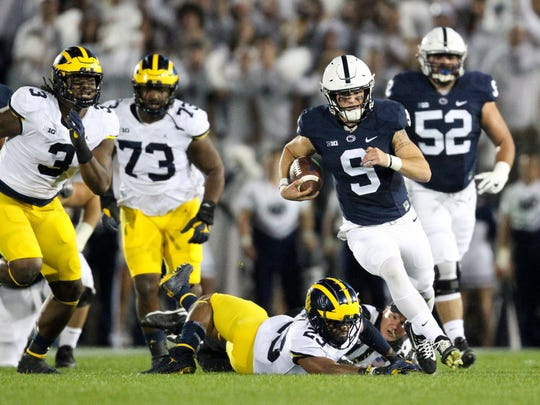 Penn State QB Trace McSorley (9) runs with the ball during the first quarter against the Michigan Wolverines on Saturday, October 21, 2017 at Beaver Stadium in University Park, Pa.