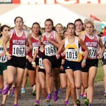 Milford runners (from left) Mallory Barrett (1067), Nicole Grindling (1068), Paige Saiz and Victoria Heilgenthal (1072) come out of the chute at the MHSAA Division 1 state finals at MIS.