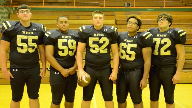 New Iberia's returning offensive line of Travis Landry (55), Isaiah Romero (59), Kalin Nero (52), Devin Gabriel (65) and Logan Manzo (72) is hoping to elevate the Jackets' offense this season.