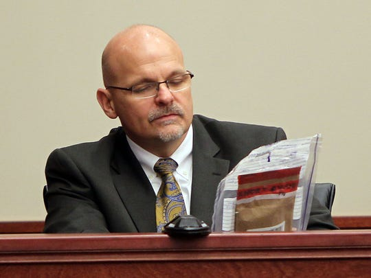 Highland Heights Police Chief Bill Birkenhauer identifies a cell phone as that of murder victim Ryan Poston during testimony at the trial of Shayna Hubers.