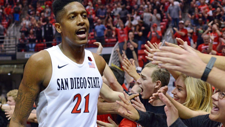 SDSU's Malik Pope celebrates with fans after a 78-71
