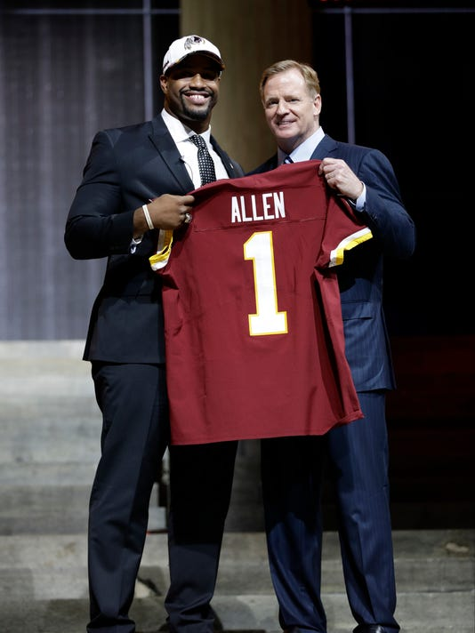 Alabama's Jonathan Allen, left, poses with NFL commissioner Roger Goodell after being selected by the Washington Redskins during the first round of the 2017 NFL football draft, Thursday, April 27, 2017, in Philadelphia. (AP Photo/Matt Rourke)