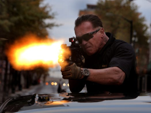 "An exclusive sneak peek of 'Sabotage.' Arnold Schwarzenegger stars as DEA agent John ""Breacher"" Wharton in the thriller out April 2014. Under the direction of David Ayer, even the iconic action star had to have a month of training to act, shoot and think like a DEA agent. In this scene, Wharton tries to stop a fleeing enemy. ""Here, the only way to stop them is to use a high-powered automatic machine gun and to try to whack them,"" says Schwarzenegger."