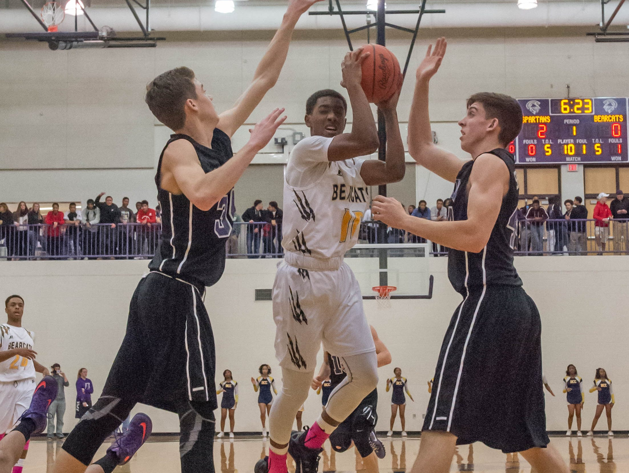 Battle Creek Central's Jahmiel Wade (10) goes for the basket past Lakeview defenders during Friday evening's game.