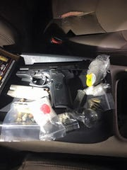 Salinas police seized a gun and narcotics during a traffic stop on Saturday.