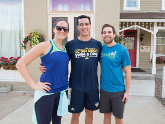 University of California-San Diego alumni and former swimmers visited Indianapolis for the NCAA Swimming and Diving Championships, From left, Shannon Simonds, Nick Korth and Kyle Begovich pose for a photo in front of the home they rented in Lockerbie. Square. The three are part of a large alumni group with spouses and children who couldn't find a hotel due to late planning and high hotel occupancy for to the Big Ten Championship taking place the same weekend.