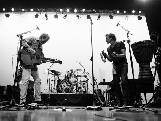 Michael (left) and Kevin Bacon perform onstage as The