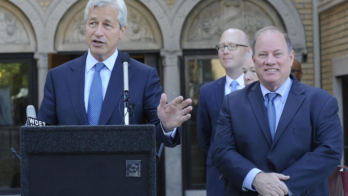 Jamie Dimon, CEO of JPMorgan Chase, left, and Mayor Mike Duggan both stress the importance of collaboration.