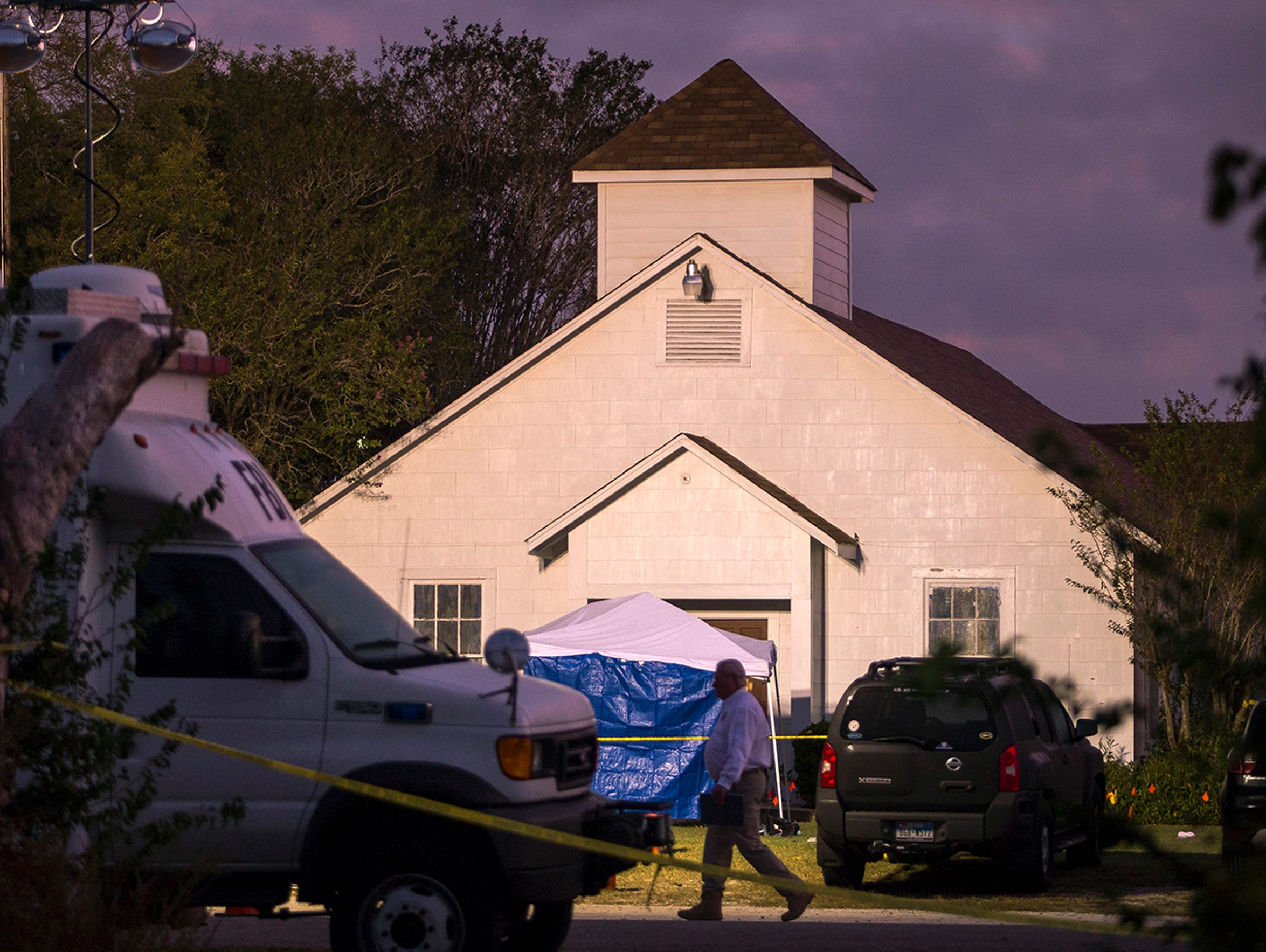 A man walks past the front of the First Baptist Church