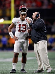 Alabama offensive coordinator Brian Daboll speaks with quarterback Tua Tagovailoaon during the second half  of college football's national championship game in Atlanta in January. Alabama won the game in overtime and Daboll moved on to become the Buffalo Bills offensive coordinator.