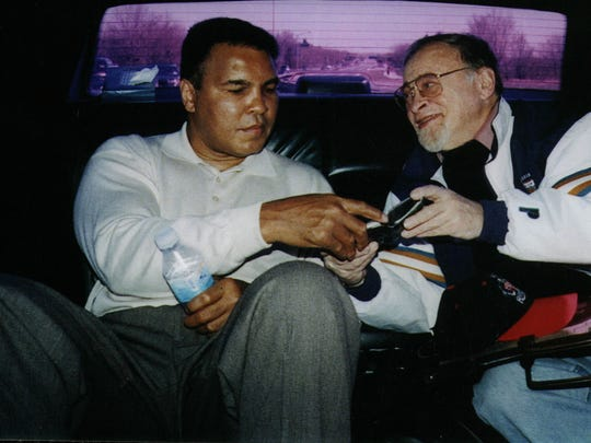 Muhammad Ali and Jerry Izenberg in 1991.