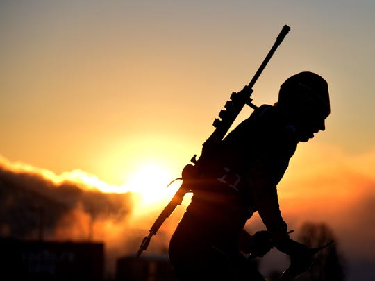 A biathlete skis under a sunset during a training session at the Laura Cross Country Skiing and Biathlon Centre in Rosa Khutor, near Sochi, on February 5, 2014. The Sochi Olympic Winter Games 2014 will run from February 7 to 23.