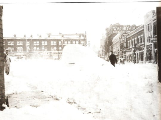 Asheville typically gets about 9 inches of a snow a year, but we're no stranger to an occasional blizzard. This file photo shows snow piled high on Patton Avenue after the March 17, 1936, blizzard, which dumped 12-20 inches of snow in the mountains.