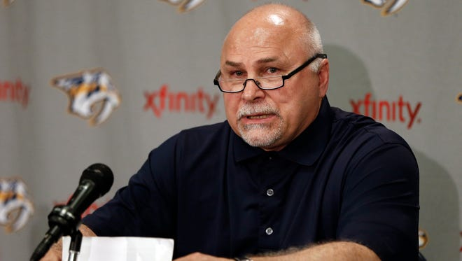 Barry Trotz answers questions at a news conference on Monday after the Nashville Predators said they weren't renewing his contract.