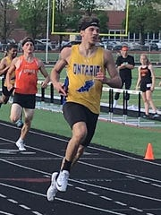 Ontario's Ethan Pensante wins the 200, to go with his victories in the 100 and as anchor of the 4x200 at the Mid-Ohio Athletic Conference meet.