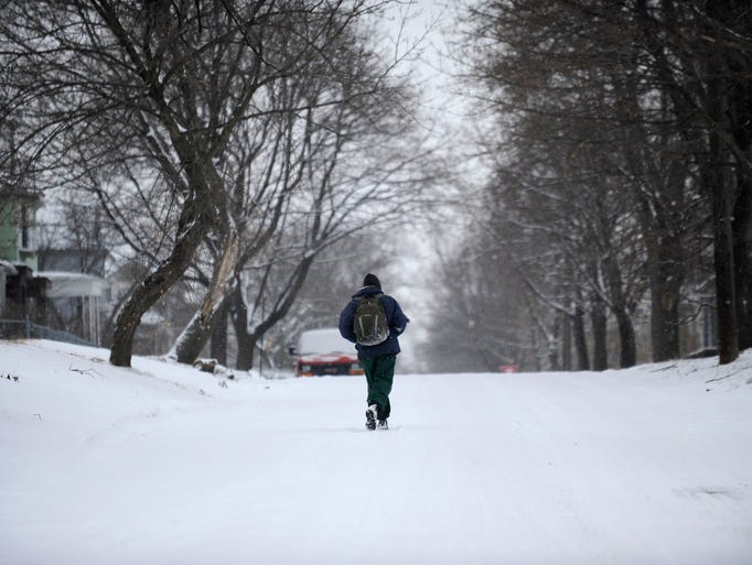 A lone figure walks through the snow on Belvidere in